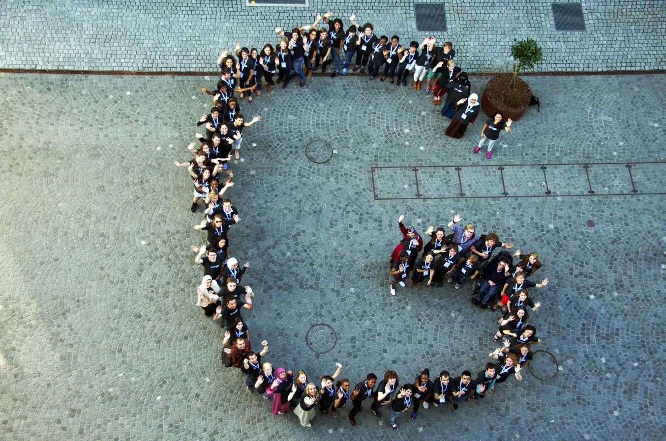 """EMEA Scholars form a """"G"""" shape."""