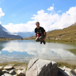 Jumping in the air whilst hiking around the Matterhorn