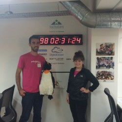 Sam and Julie in-front of the TechStars countdown clock